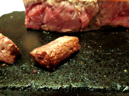 House of Wagyu Cooking Steak on Stone Slab