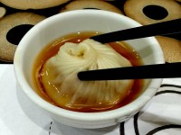 Lugang Xiao Long Bao Dipping in Sauce